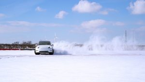 model y drifting in the snow